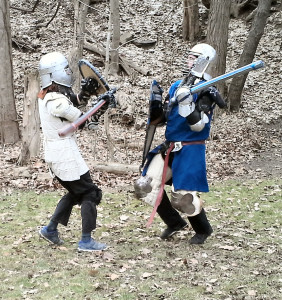 A youth fighter working with a sparring marshal in the Debatable Lands.