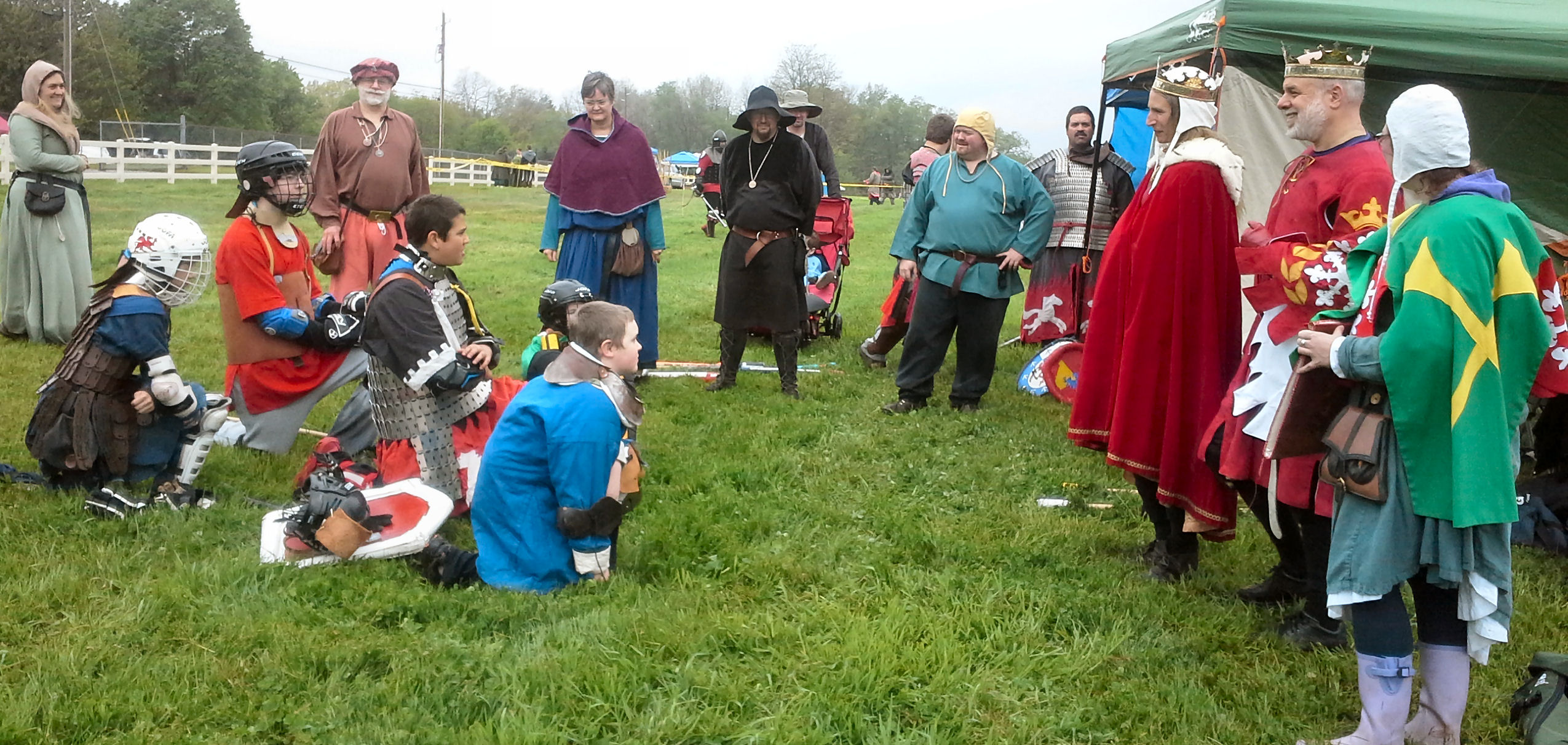 Their Majesties address the fighters at the start of the tourney. Photo by Arianna of Wynthrope.